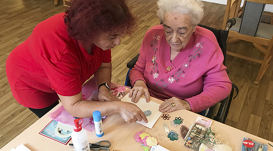 A St martins Care Home resident doing craftwork
